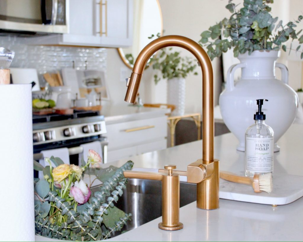 The Moen Gold Faucet and Soap Dispenser