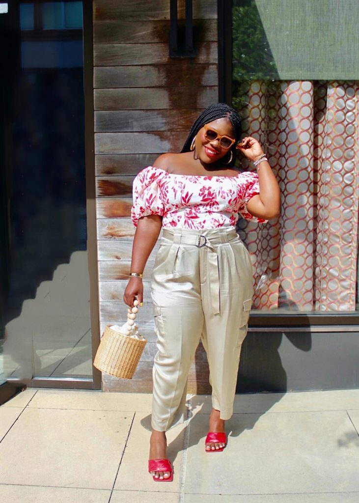 Cargo pants styled with puff sleeve top and basket bag and red mules